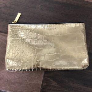 Estée Lauder new gold snakeskin makeup bag